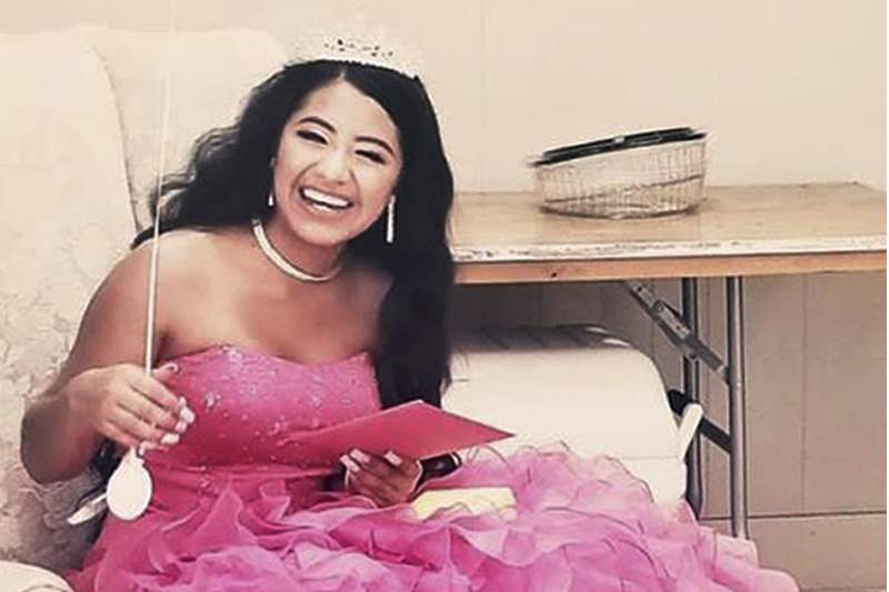 """In this February 2021 photo provided by Caring Place@ Miami Rescue Mission, Adriana Palma wears a tiara and ballgown on her quinceanera, her 15th birthday celebration. Quinceaneras are revered in Hispanic culture and celebrated with all the gusto of a wedding. But after her father lost his job, Adriana said, """"I lost all hope of having one."""""""