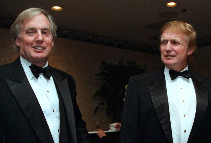 FILE - In this Nov. 3, 1999 file photo, Robert Trump, left, joins real estate developer and presidential hopeful Donald Trump at an event in New York. A tell-all book by President Donald Trump's niece cannot be published until a judge decides the merits of claims by the president's brother, her uncle Robert Trump, that its publication would violate a pact among family members, a judge said Tuesday, June 30, 2020. (AP Photo/Diane Bonadreff, File)
