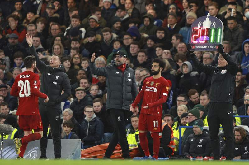 Liverpool's manager Jurgen Klopp, center, shouts out from the touchline as Liverpool's Adam Lallana, left, is substituted by Liverpool's Mohamed Salah during the English FA Cup fifth round soccer match between Chelsea and Liverpool at Stamford Bridge stadium in London Tuesday, March 3, 2020. (AP Photo/Ian Walton)