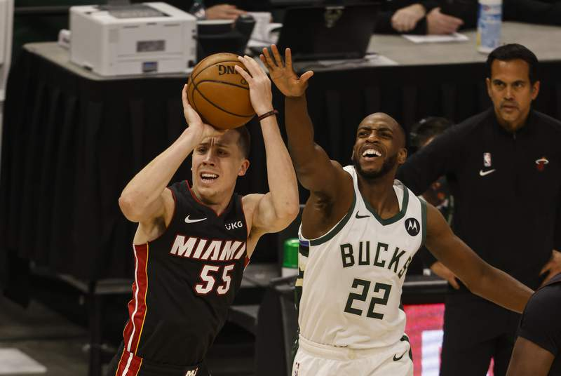 Milwaukee Bucks forward Khris Middleton (22) guards against Miami Heat guard Duncan Robinson (55) during the first half of Game 2 of their NBA basketball first-round playoff series Monday, May 24, 2021, in Milwaukee. (AP Photo/Jeffrey Phelps)