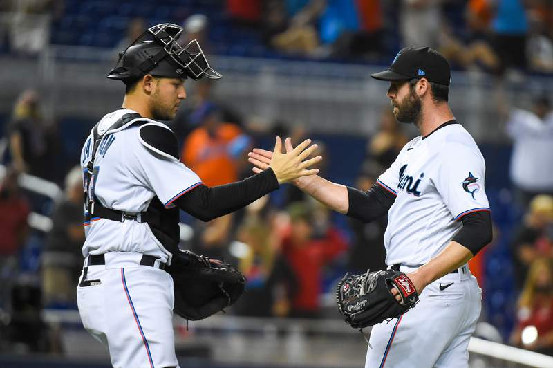 Dylan Floro of the Miami Marlins is congratulated by Alex Jackson after defeating the against the New York Mets at loanDepot park on August 3, 2021 in Miami, Florida.