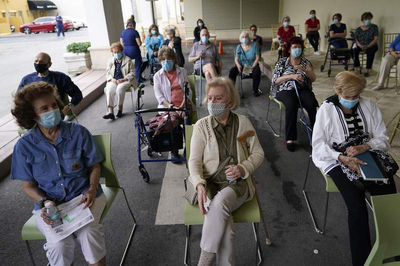 In this Jan. 12 photo, residents wait to be cleared after receiving the Pfizer-BioNTech COVID-19 vaccine at the The Palace assisted living facility in Coral Gables.