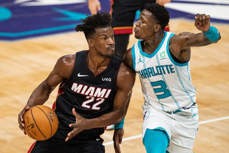Jimmy Butler of the Miami Heat drives to the basket while guarded by Terry Rozier of the Charlotte Hornets in the second quarter at Spectrum Center on May 02, 2021 in Charlotte, North Carolina.
