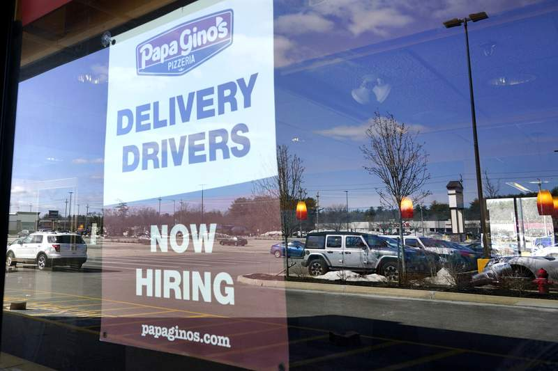 """A """"Now Hiring"""" sign is displayed, Thursday, March 4, 2021, in Salem, N.H. U.S. employers added a surprisingly robust 379,000 jobs in February in a sign the economy is strengthening as virus cases drop, vaccinations ramp up, Americans spend more and states ease business restrictions. (AP Photo/Elise Amendola)"""