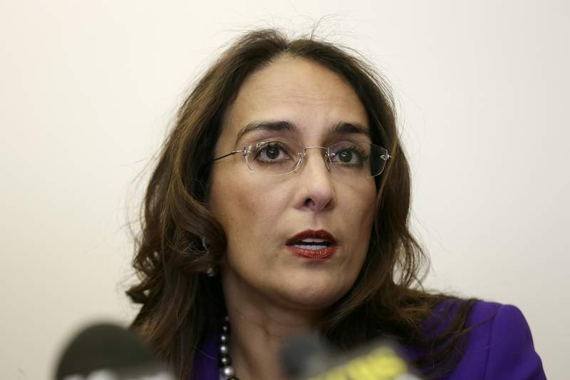 FILE - In this April 24, 2017, file photo, attorney Harmeet Dhillon speaks during a news conference in San Francisco. The lawyer leading the fight against California's stay-at-home orders has a long history of taking on free speech and civil rights cases. Dhillon has filed more than a dozen lawsuits challenging pieces of Gov. Gavin Newsom's stay-at-home orders. (AP Photo/Eric Risberg, File)