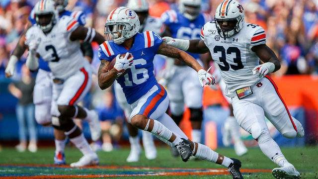 Florida Gators wide receiver Freddie Swain scores a touchdown during the first quarter against the Auburn Tigers.