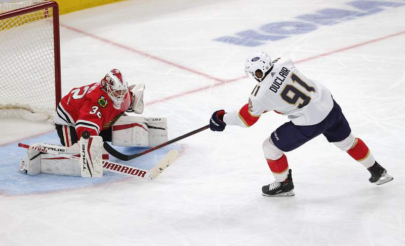 Kevin Lankinen of the Chicago Blackhawks stops a shot by Anthony Duclair of the Florida Panthers at the United Center on March 25, 2021 in Chicago, Illinois.