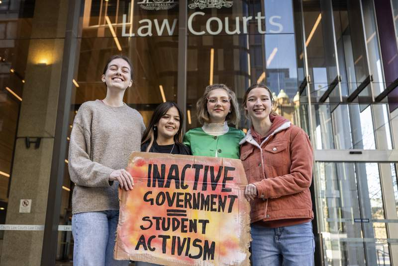 Australian child environmentalists, Laura Kirwin, Izzy Raj-Seppings, Ava Princi and Liv Heaton pose for a photo outside the Federal Court of Australia in Sydney, Thursday, May 27, 2021. Eight children, aged 13 to 17, lost their court bid Thursday to force the federal government to ban a coal mine expansion and had argued in the Federal Court that Environment Minister Sussan Ley had a duty of care to protect younger people against climate change. (James Gourley/AAPImage via AP)