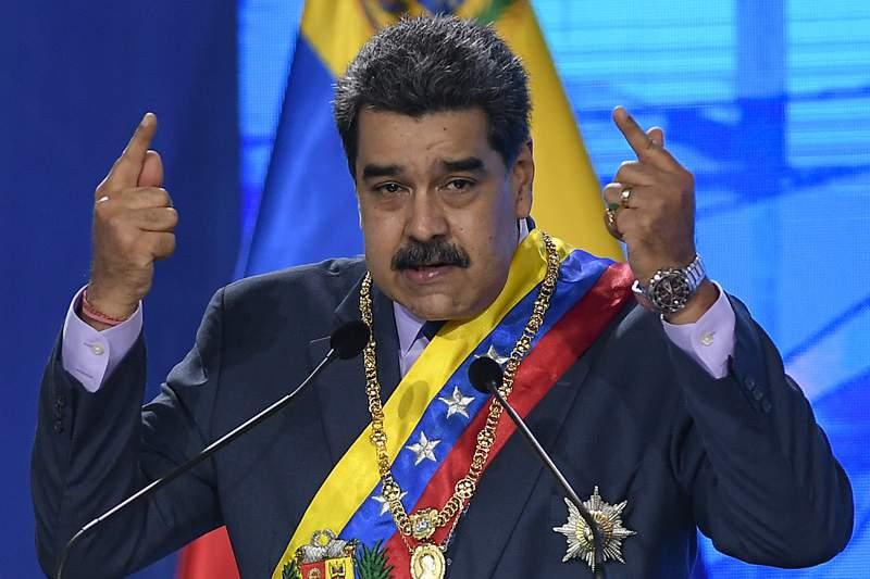 Venezuelan President Nicolas Maduro speaks during a ceremony marking the start of the judicial year at the Supreme Court in Caracas, Venezuela, Friday, Jan. 22, 2021. (AP Photo/Matias Delacroix)
