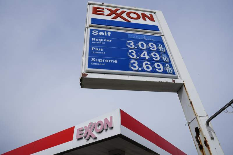 Gas prices are shown on a Exxon service station sign in Philadelphia, Wednesday, April 28, 2021.  Commodities like plastic, paper, sugar and grains are all getting more expensive as demand outpaces supply. Companies are also paying more for shipping as fuel costs rise and ports experience longer delays because of congestion. (AP Photo/Matt Rourke)