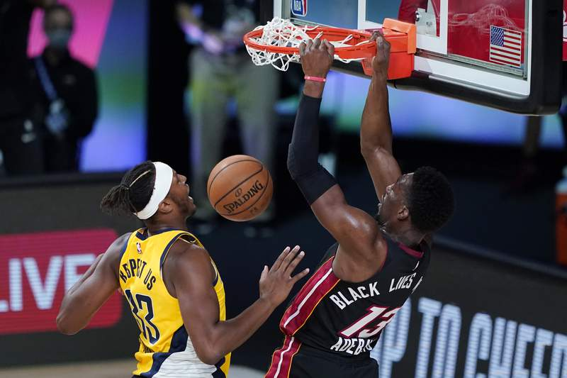 Bam Adebayo scores against Myles Turner during Game One of the Eastern Conference First Round during the 2020 NBA Playoffs at AdventHealth Arena at ESPN Wide World Of Sports Complex on August 18, 2020.