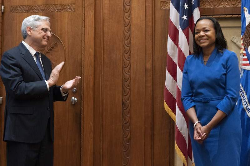 Kristen Clarke, newly sworn in as assistant attorney general for civil rights, reacts as she is congratulated by Attorney General Merrick Garland, left, Tuesday, May 25, 2021, at the Justice Department in Washington. (AP Photo/Jacquelyn Martin)