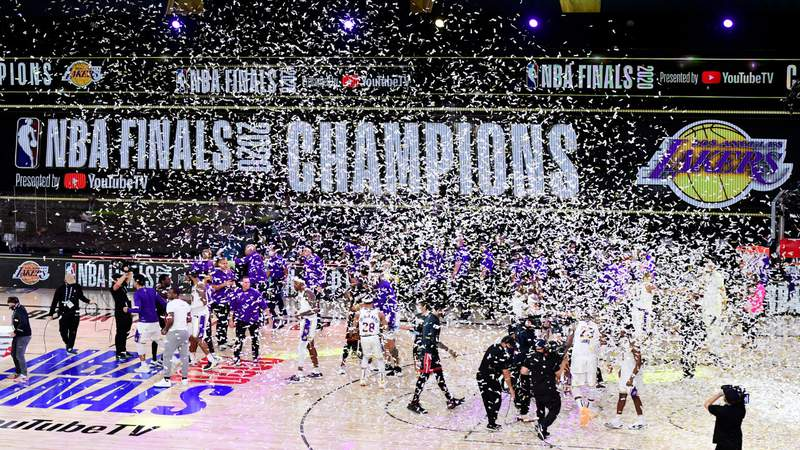 The Los Angeles Lakers celebrate with the trophy after winning the 2020 NBA Championship Final over the Miami Heat in Game Six of the 2020 NBA Finals. Photo by Douglas P. DeFelice.