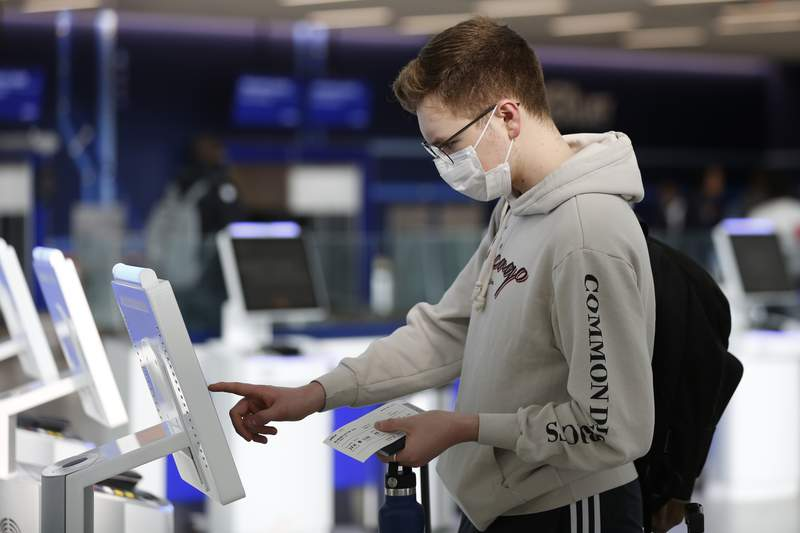 New York University student Hector Medrano checks into for his flight at JetBlue's terminal in John F. Kennedy International Airport in New York last month. (AP Photo/Kathy Willens)