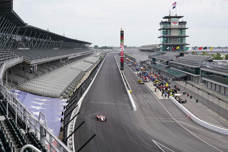 Drivers head to the track as practice opened for the Indianapolis 500 auto race at Indianapolis Motor Speedway in Indianapolis, Wednesday, Aug. 12, 2020. (AP Photo/Michael Conroy)