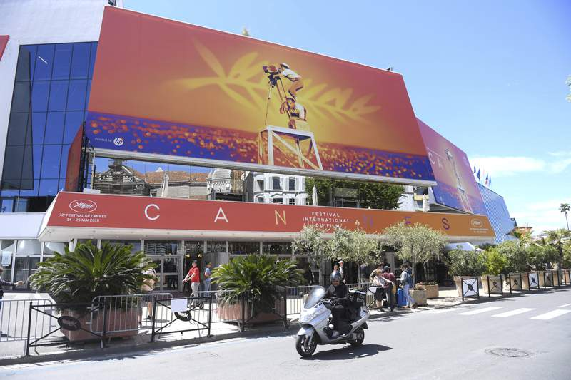 FILE - This May 13, 2019 file photo shows a view of the Palais des festivals during the 72nd international film festival, Cannes, southern France. Arguably the worlds most prestigious film festival and cinemas largest annual gathering has postponed its 73rd edition. Organizers of the French Riviera festival, scheduled to take place May 12-23, said they are considering moving the festival to the end of June or the beginning of July. (Photo by Arthur Mola/Invision/AP, File)