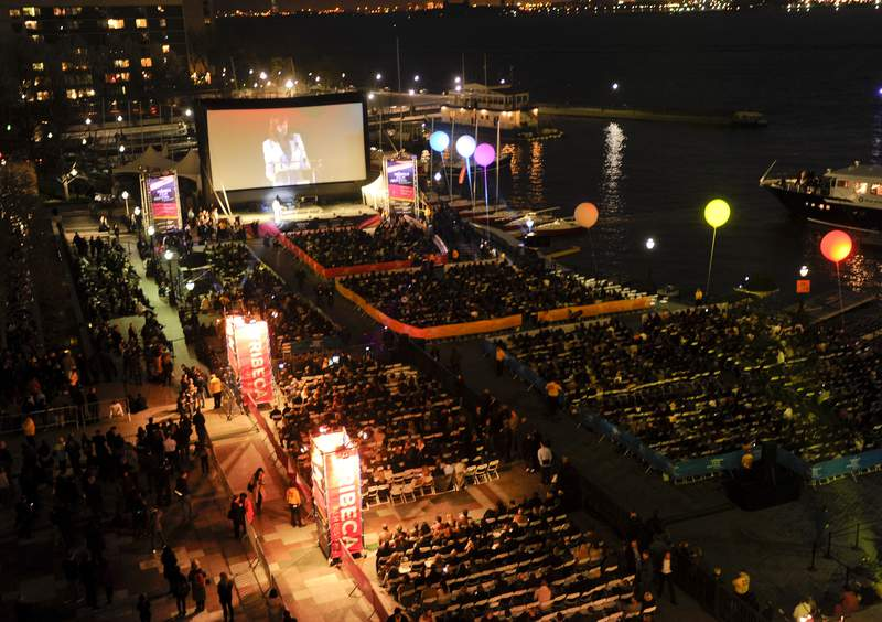 """FILE - People attend an outdoor screening  for """"The Union"""" at the opening night gala of the Tribeca Film Festival in New York on April 20, 2011. The Tribeca Film Festival said Monday, March 29, 2021, it plans to hold its 20th edition in-person and with outdoor screenings in June. (AP Photo/Evan Agostini, File)"""