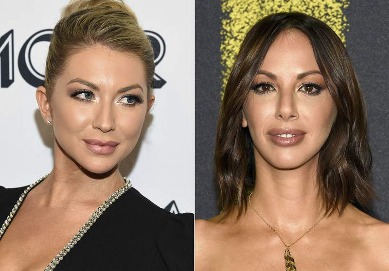 """In this combination photo, Stassi Schroeder attends the Glamour Women of the Year Awards in New York on Nov. 11, 2019, left, and Kristen Doute arrives at the Los Angeles premiere of """"Pitch Perfect 3"""" on Dec. 12, 2017. Schroeder and Doute are among four cast members of the Bravo TV series """"Vanderpump Rules"""" who will not be returning for another season of the series. It was revealed last week that Schroeder and Doute had reported a former African American coworker, Faith Stowers, for a crime she had nothing to do with. Stowers appeared on two seasons of Vanderpump. (AP Photo)"""