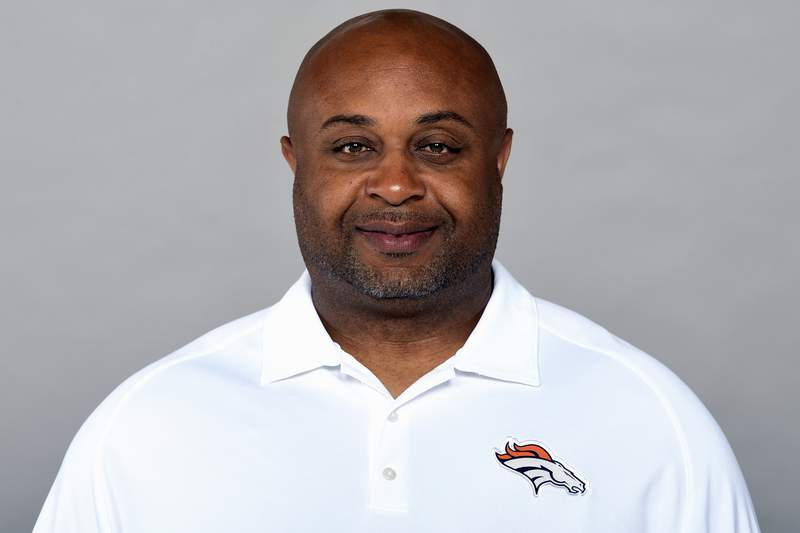 This is a 2019 photo of Curtis Modkins of the Denver Broncos NFL football team. Modkins has tested positive for COVID-19 and wont accompany the team on its trip to New England. The Broncos said they learned of Modkins diagnosis early Saturday, Oct. 17, 2020. (AP Photo/File)