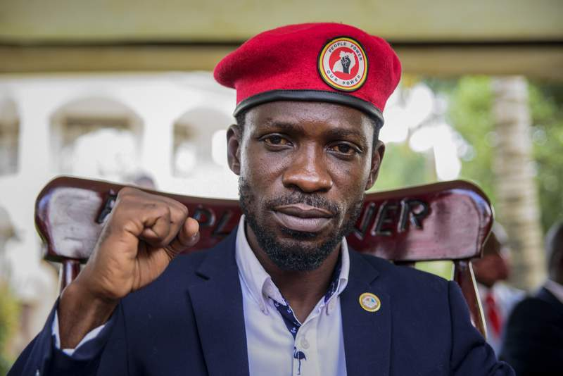 FILE - In this Tuesday, Jan. 26, 2021 file photo, opposition presidential challenger Bobi Wine, whose real name is Kyagulanyi Ssentamu, gestures as he speaks to the media outside his house after government soldiers withdrew from it, in Magere, near Kampala, in Uganda. Ugandan opposition leader Bobi Wine on Monday, Feb. 15, 2021 released a list of 243 people who have allegedly been abducted by the security forces, piling pressure on the government to find those missing amid continuing political tensions after last month's elections. (AP Photo/Nicholas Bamulanzeki, File)