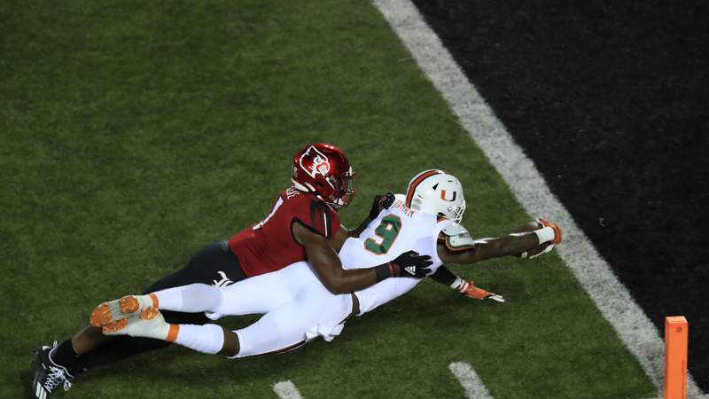 Brevin Jordan #9 of the Miami Hurricanes dives for the goal line against the Louisville Cardinals at Cardinal Stadium on September 19, 2020 in Louisville, Kentucky. (Photo by Andy Lyons)