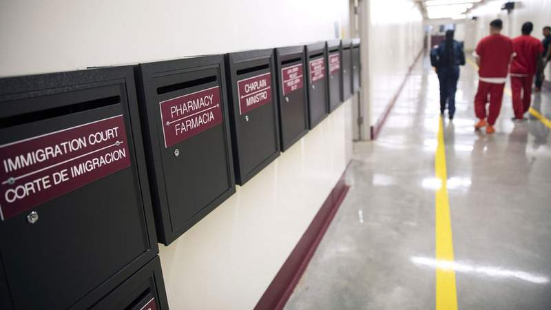 Mail boxes for various departments line a hallway as detainees walk through the Stewart Detention Center, Friday, Nov. 15, 2019, in Lumpkin, Ga. AP Photo/David Goldman