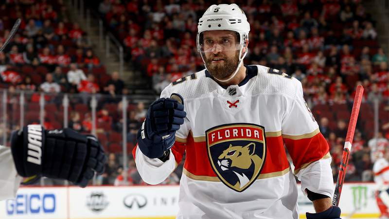 Aaron Ekblad of the Florida Panthers celebrates teammate Brett Connolly's goal against the New Jersey Devils at Prudential Center on February 11, 2020.