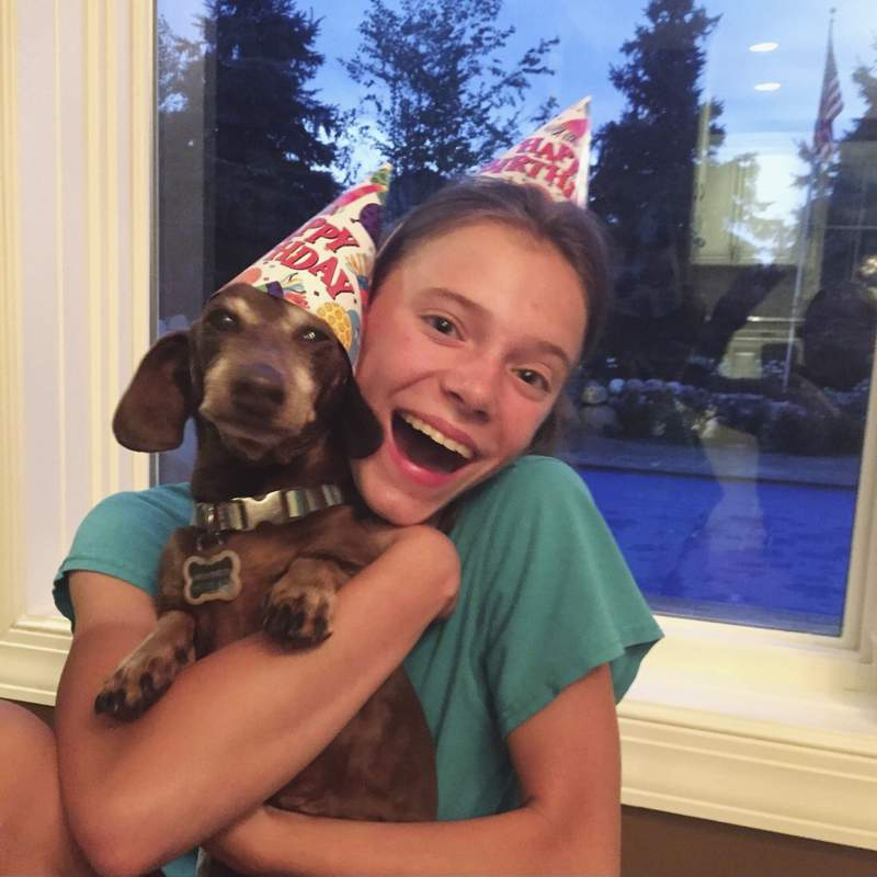 This August 2020 photo provided by Peyton Crest shows her with her dog at home in Minnetonka, Minn. The 18-year-old ays she developed anorexia before the pandemic but has relapsed twice since it began. It was my junior year, I was about to apply for college, Crest says. Suddenly deprived of friends and classmates, her support system, shed spend all day alone in her room and became preoccupied with thoughts of food and anorexic behavior. (Courtesy Peyton Crest via AP)