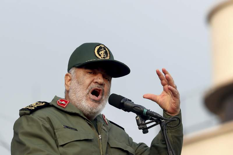 FILE - In this Monday, Nov. 25, 2019 file photo, Chief of Iran's Revolutionary Guard Gen. Hossein Salami speaks at a pro-government rally, in Tehran, Iran. The chief of Irans paramilitary Revolutionary Guard has threatened to go after everyone who had a role in a top generals January killing during a U.S. drone strike in Iraq. The guards website on Saturday, Sept. 19, 2020 quoted Gen. Hossein Salami as saying, Mr. Trump! Our revenge for martyrdom of our great general is obvious, serious and real. U.S. President Donald Trump warned this week that Washington would harshly respond to any Iranian attempts to take revenge for the death of Gen. Qassem Soleimani.  (AP Photo/Ebrahim Noroozi, File)