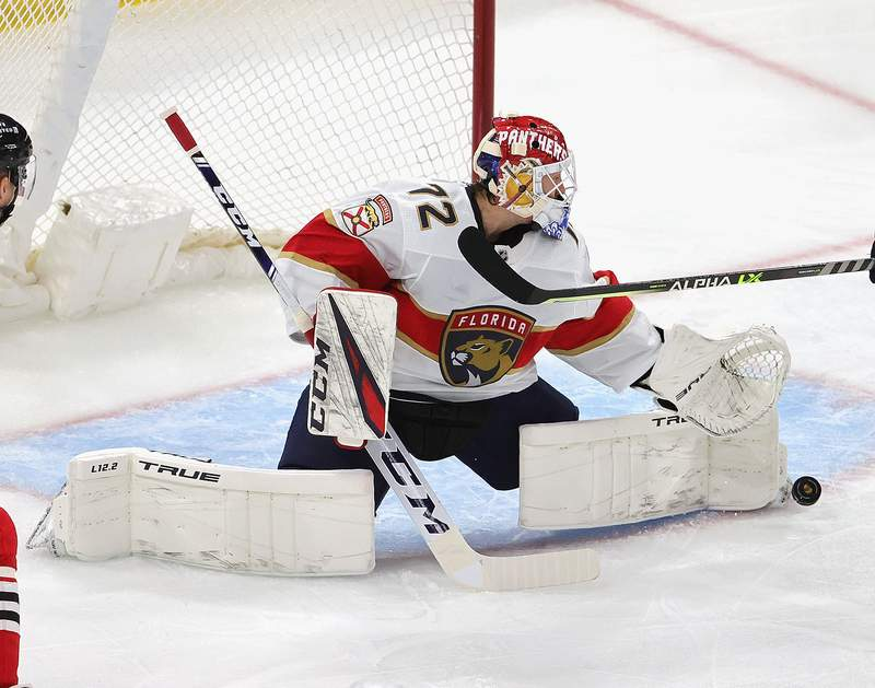 Sergei Bobrovsky of the Florida Panthers makes a save against the Chicago Blackhawks at the United Center on March 25, 2021 in Chicago, Illinois.