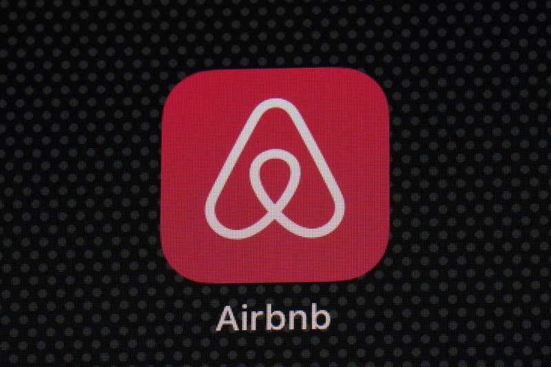 FILE - In this Saturday, May 8, 2021, file photo, the Airbnb app icon is seen on an iPad screen, in Washington. Airbnb said Thursday, Aug. 12, 2021, that it narrowed its second-quarter loss to $68 million and saw an increase in bookings, but the company warned that new variants of COVID-19 will make future bookings and cancellations harder to predict. (AP Photo/Patrick Semansky, File)