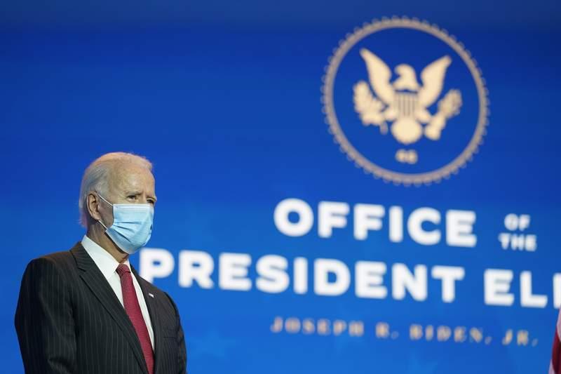President-elect Joe Biden, accompanied by Vice President-elect Kamala Harris, prepares to speak at The Queen theater, Thursday, Nov. 19, 2020, in Wilmington, Del. (AP Photo/Andrew Harnik)