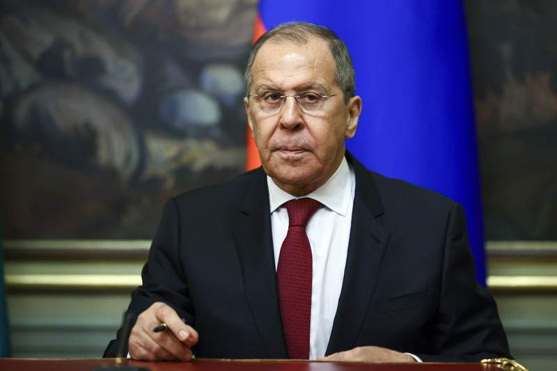 """In this  photo released by the Russian Foreign Ministry Press Service, Russian Foreign Minister Sergey Lavrov attends a signing ceremony with his Turkmenistan's counterpart Rasit Meredow following their talks in Moscow, Russia, Thursday, April 1, 2021. Lavrov said Thursday that the Russian-U.S. relations have """"hit the bottom,"""" adding there is no plan yet to send the Russian ambassador back to Washington. (Russian Foreign Ministry Press Service via AP)"""