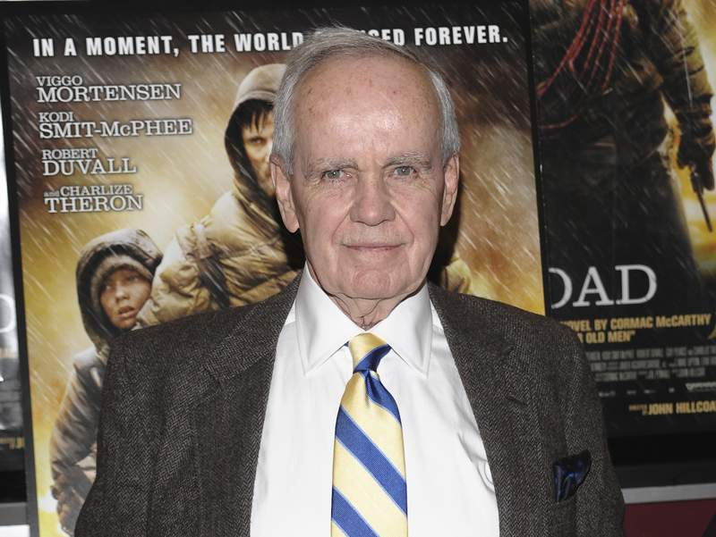 """FILE - Author Cormac McCarthy attends the premiere of """"The Road"""" in New York on Nov. 16, 2009. The Twitter account for the famous, and famously media-shy author is fake. The McCarthy account, @CormacMcCrthy, had more than 48,000 followers as of midday Monday, among them Stephen King. It was established in September 2018, but was only recently given a blue check for verification. (AP Photo/Evan Agostini, File)"""