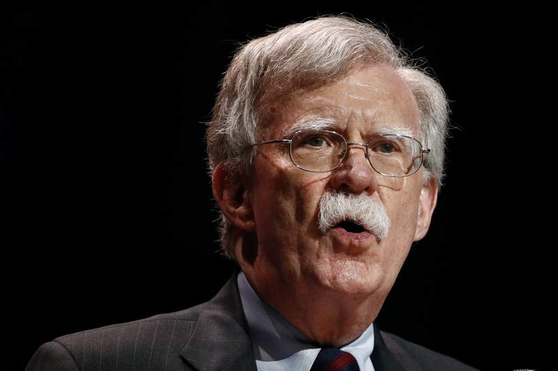 FILE - In this July 8, 2019, file photo, national security adviser John Bolton speaks at the Christians United for Israel's annual summit, in Washington.  A single paper copy in a nondescript envelope arrived at the White House on Dec. 30. Four weeks later, news of John Boltons book manuscript about his time as President Donald Trumps national security adviser has exploded into public view, sending a jolt through the presidents impeachment trial. (AP Photo/Patrick Semansky, File)