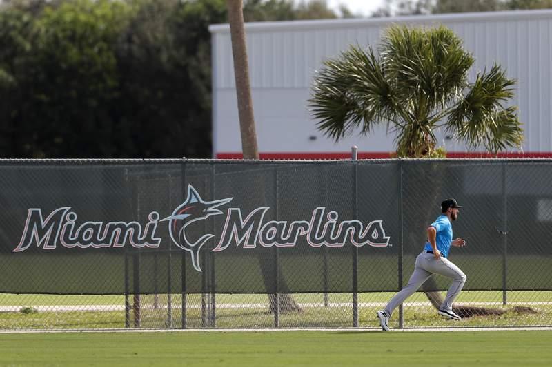 A Miami Marlins pitcher runs sprits during spring training baseball practice Sunday, Feb. 16, 2020, in Jupiter, Fla. (AP Photo/Jeff Roberson)