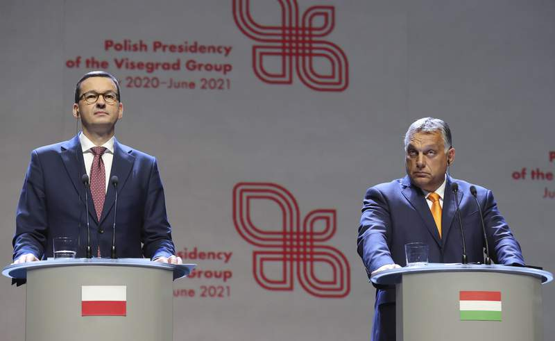 FILE - In this Friday, Sept. 11, 2020 file photo, Viktor Orban, right, Prime Minister of Hungary and Polish Prime Minister Mateusz Morawiecki attend a news conference following talks with his counterparts from central Europe's Visegrad Group in Lublin, Poland. Poland and Hungary have vetoed the European Unions next seven-year budget and coronavirus recovery plan over a new mechanism that links EU funding to the rule of law. The 27-nation blocs 1.8 trillion euro ($2.1 trillion) budget for 2021-2027 was agreed upon last week after tough negotiations. The budget is supposed to take effect on Jan. 1. (AP Photo/Czarek Sokolowski, file)