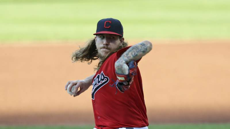 Cleveland Indians starting pitcher Mike Clevinger delivers in the first inning in a baseball game against the Cincinnati Reds, Wednesday, Aug. 5, 2020, in Cleveland. (AP Photo/Tony Dejak)