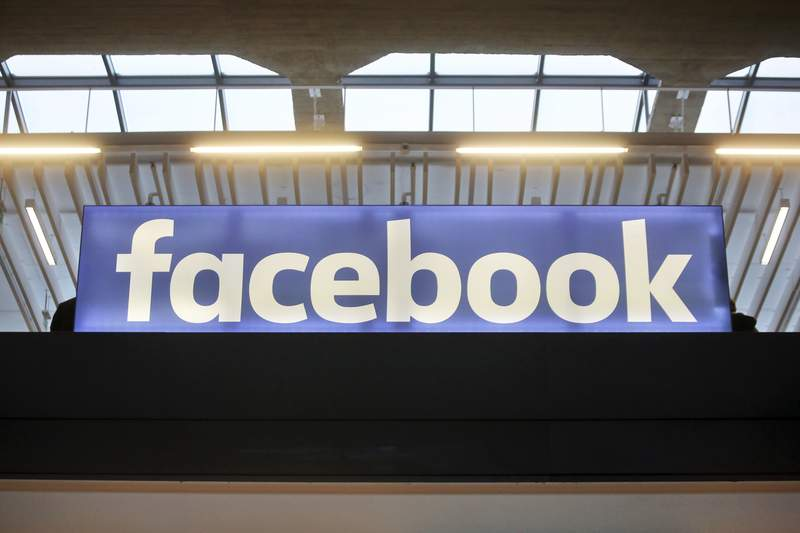 FILE - In this Tuesday, Jan. 17, 2017, file photo, the Facebook logo is displayed at a gathering for startup companies at Paris' Station F. Facebook has allowed groups, many tied to QAnon and militia movements, to glorify violence during the 2020 election, a new report has found. (AP Photo/Thibault Camus, File)