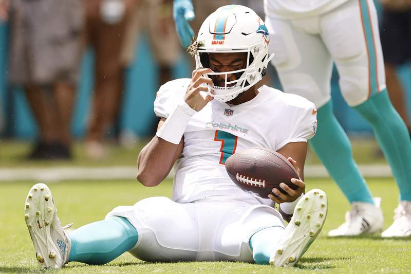 Tua Tagovailoa of the Miami Dolphins reacts after being sacked against the Buffalo Bills during the first quarter at Hard Rock Stadium on September 19, 2021 in Miami Gardens, Florida.