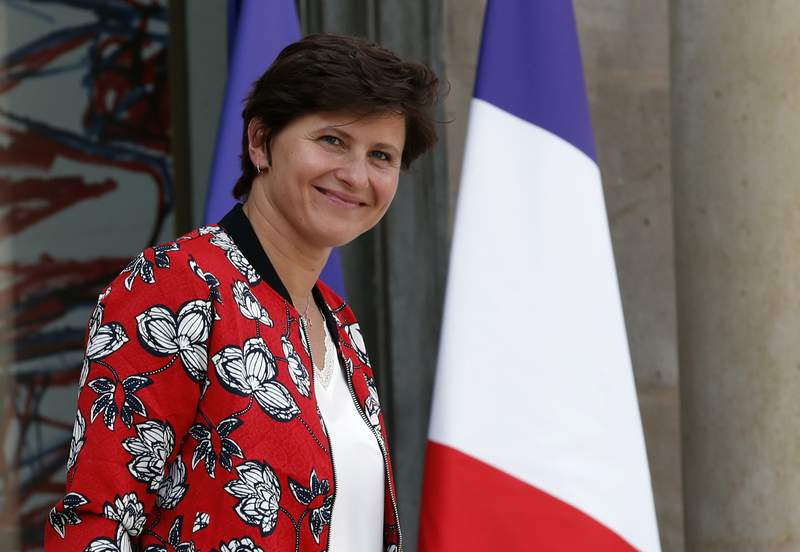 FILE - In this Wednesday, Sept. 5, 2018 file photo, French Sports Minister Roxana Maracineanu leaves the Elysee Palace after the weekly cabinet meeting, in Paris. A year-long, nationwide French effort to uncover and combat sexual violence in sports has identified more than 400 coaches, teachers and others suspected of abuse or covering it up.  Most of the victims were under 15, according to data released Friday April 2, 2021, by the sports ministry. (AP Photo/Christophe Ena, File)