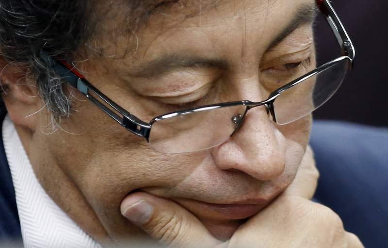 FILE - In this Dec. 4, 2018 file photo, Senator Gustavo Petro pauses during an interview at a local radio station in Bogota, Colombia. The former presidential candidate has adopted a low-key approach during the anti-government protests that started in late April 2021 ahead of his third run for Colombias presidency. AP Photo/Fernando Vergara, File)