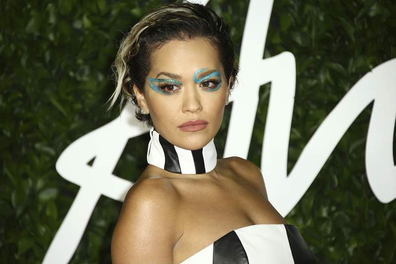FILE - In this Monday, Dec. 2, 2019 file photo, singer Rita Ora poses for photographers upon her arrival at the British Fashion Awards in central London. British singer Rita Ora apologized Monday Nov. 30, 2020, for breaking lockdown rules by holding a birthday party, saying it was a serious and inexcusable error of judgment. (Photo by Joel C Ryan/Invision/AP, File)