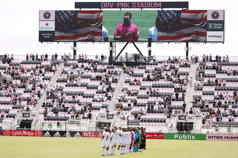 The Inter Miami CF and Atlanta United observe the playing of the national anthem prior to the game at DRV PNK Stadium on May 09, 2021 in Fort Lauderdale, Florida.