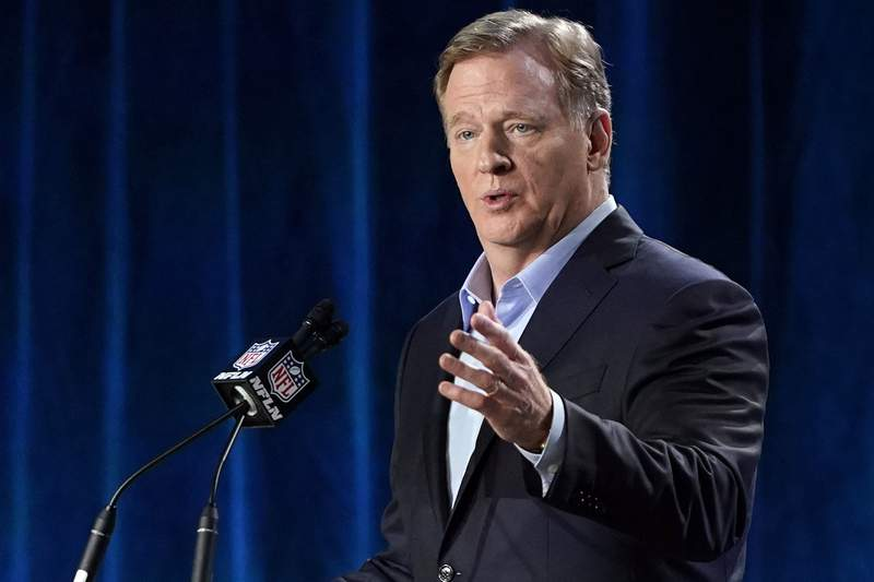 FILE - In this Jan. 29, 2020, file photo, NFL Commissioner Roger Goodell answers a question during a news conference for the NFL Super Bowl 54 football game in Miami. Goodell says the league remains committed to finishing the regular season as scheduled. Goodell also said on a conference call that while the NFL is considering a bubble format for the playoffs, it wouldnt necessarily resemble what the NHL and NBA used successfully in completing their seasons. (AP Photo/David J. Phillip, File)