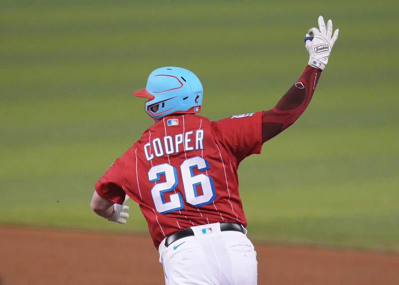 Garrett Cooper of the Miami Marlins celebrates as he runs the bases after hitting a two run walk off homerun in the bottom of the ninth inning to defeat the New York Mets by score of 3 -1 at loanDepot park on May 22, 2021 in Miami, Florida.