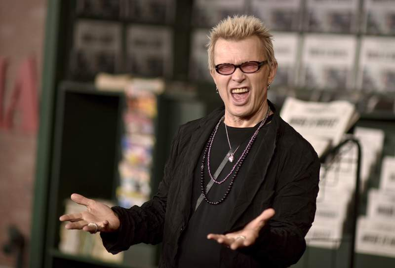 """FILE - This Oct. 24, 2019 file photo shows Billy Idol at the Los Angeles premiere of """"The Irishman."""" Idol is the face of an anti-idling campaign launched Thursday in New York City. Billy never idles, so why should you? the '80s MTV star growls in a public service announcement intended to shame New Yorkers into shutting the engine off.  (Photo by Richard Shotwell/Invision/AP, File)"""