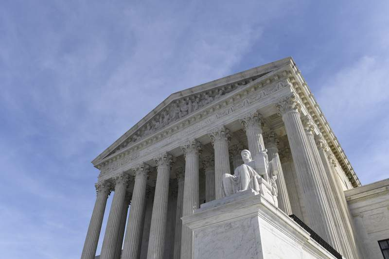 FILE - In this Nov. 11, 2019, file photo, a view of the Supreme Court in Washington. The Supreme Court appears ready to prevent thousands of people living in the U.S. for humanitarian reasons from applying to become permanent residents. The justices seemed favorable to arguments made by the Biden administration on April 19, 2021, that federal immigration law prohibits people who entered the country illegally and now have Temporary Protected Status from seeking green cards to remain in the country permanently. (AP Photo/Susan Walsh, File)