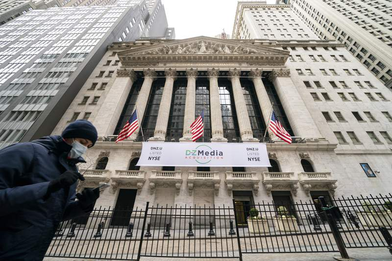FILE - Pedestrians pass the New York Stock Exchange, Wednesday, Jan. 27, 2021, in New York.  Stocks are opening higher on Wall Street following three straight days of losses. The S&P 500 rose 0.2% in the first few minutes of trading Friday, Feb. 19.   (AP Photo/John Minchillo, File)