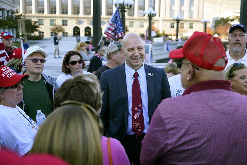 Pennsylvania state Sen. Doug Mastriano, R-Franklin, center, speaks to supporters of President Donald Trump as they demonstrate outside the Pennsylvania State Capitol, Saturday, Nov. 7, 2020, in Harrisburg, Pa., after Democrat Joe Biden defeated Trump to become 46th president of the United States. (AP Photo/Julio Cortez)